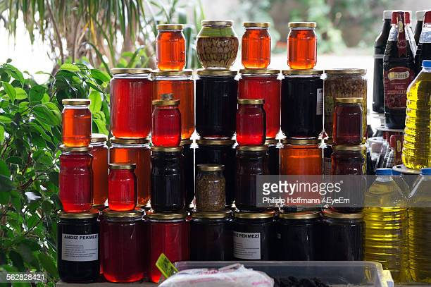 Stacked Honey And Oil Bottles For Sale At Street Market