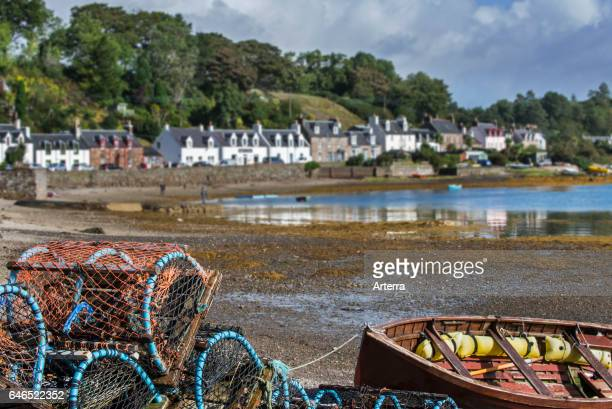 Stacked lobster creels / traps on quay in the Plockton Harbour, Scottish Highlands, Scotland, UK.