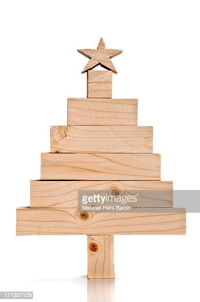 Stacked lumbers in the shape of a christmas tree