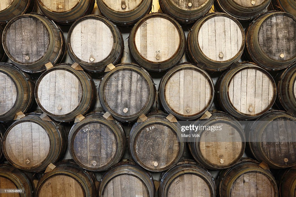 stacked oak barrels maturing red wine. Stacked Oak Barrels In A Winery Maturing Red Wine S