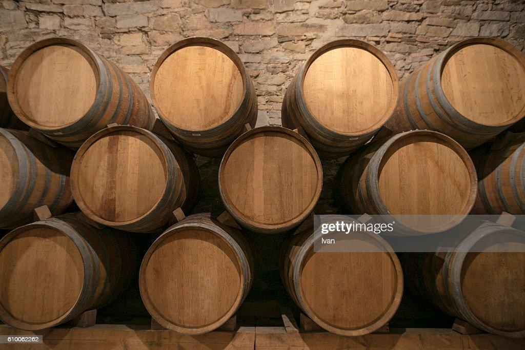 stacked oak barrels. Stacked Oak Barrels In A Winery : Stock Photo