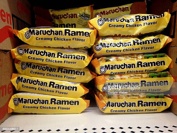 Stacked packages of dried ramen creamy chicken noodles