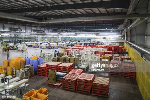 Stacked palettes sit on the warehouse floor at the Amazoncom Inc fulfillment center in Hyderabad India on Thursday Sept 7 2017 Amazon opened its...