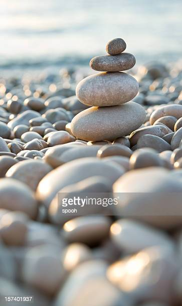 Stacked pebbles on a beach
