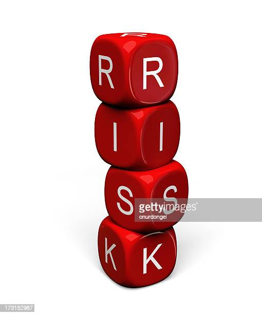 Stacked red dice with RISK on them