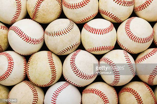 stacked rows of aged baseballs - baseball ball stock pictures, royalty-free photos & images