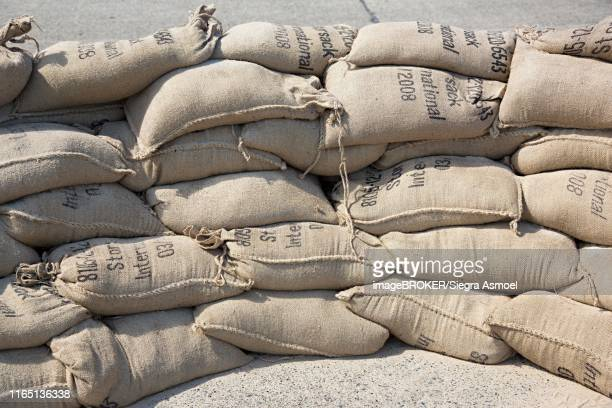 stacked sandbags, flood protection, berlin, germany - sandbag stock pictures, royalty-free photos & images