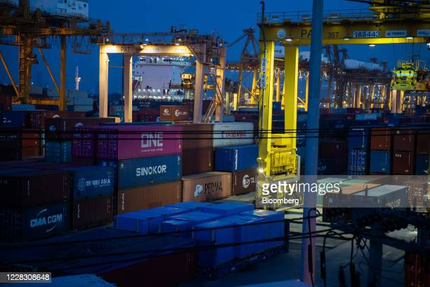 Stacked shipping containers sit among gantry cranes at the Bangkok Port in Bangkok Thailand on Wednesday Sept 2 2020 Thailand has reported zero...