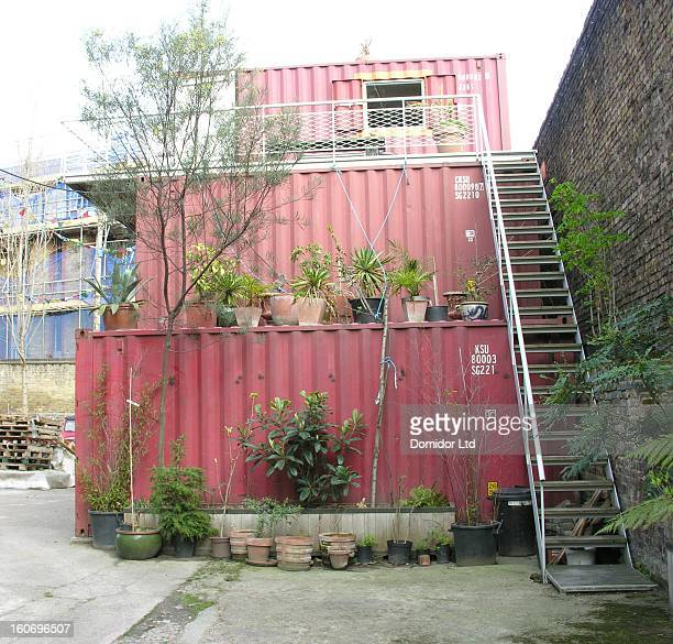 CONTENT] Stacked shipping containers used as living/working space