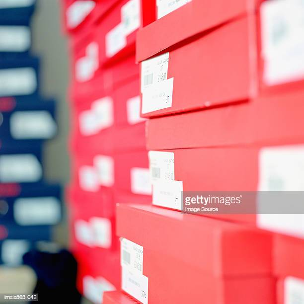 stacked shoe boxes - shoe box stock pictures, royalty-free photos & images