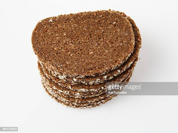 Stacked slices of brown bread, elevated view