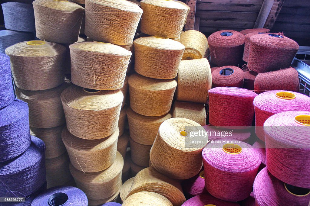 Stacked spools of dyed wool : Stock Photo
