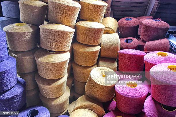 Stacked spools of dyed wool