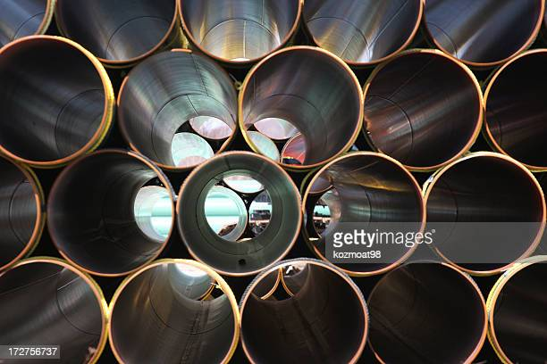 stacked steel pipe abstract - cylinder stock pictures, royalty-free photos & images