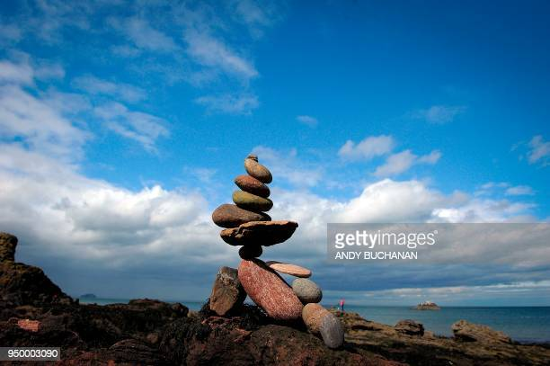 TOPSHOT Stacked stones are pictured during the European Stone Stacking Championships 2018 in Dunbar Scotland on April 22 2018 The European Stone...