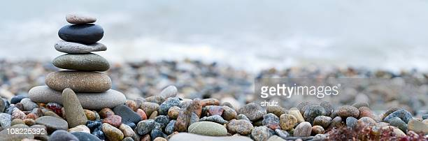 stacked stones with beautiful arrangement of colors  - pebble stock photos and pictures