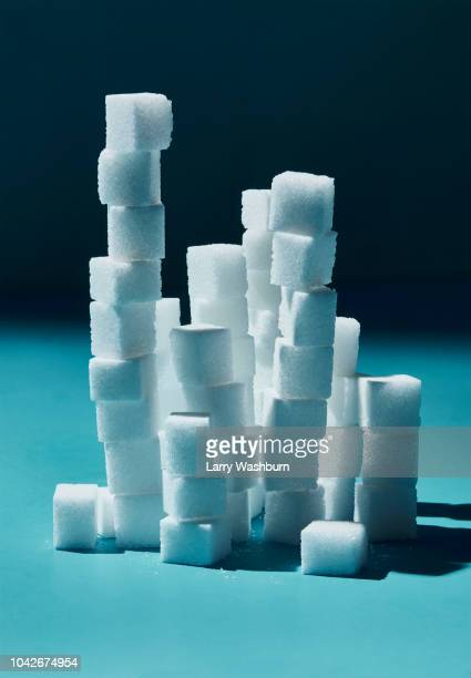 Stacked sugar cubes on blue background