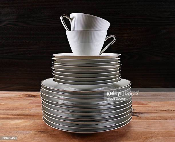 Stacked tea cups and plates