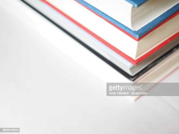 stacked textbooks - andy clement stock pictures, royalty-free photos & images
