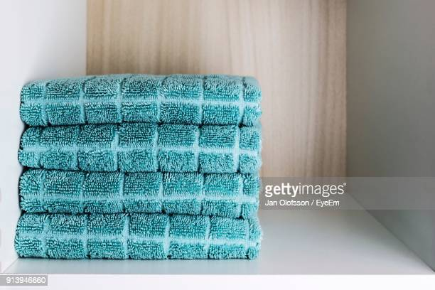 stacked towels in shelf - towel stock pictures, royalty-free photos & images