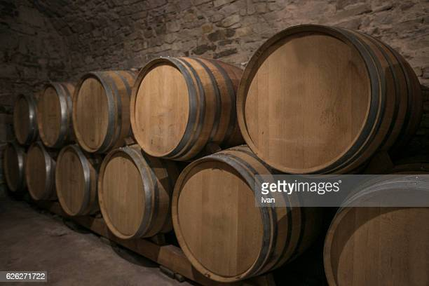 Stacked Wine Casks In Warehouse