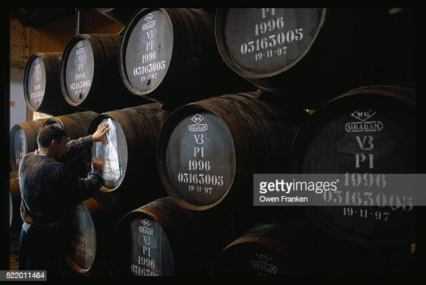 Stacked Wooden Casks Containing Port