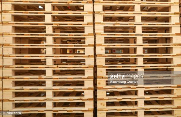 stacked wooden pallets - pallet industrial equipment stock pictures, royalty-free photos & images