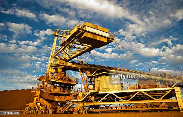 Stacker and stockpile in iron ore mine site
