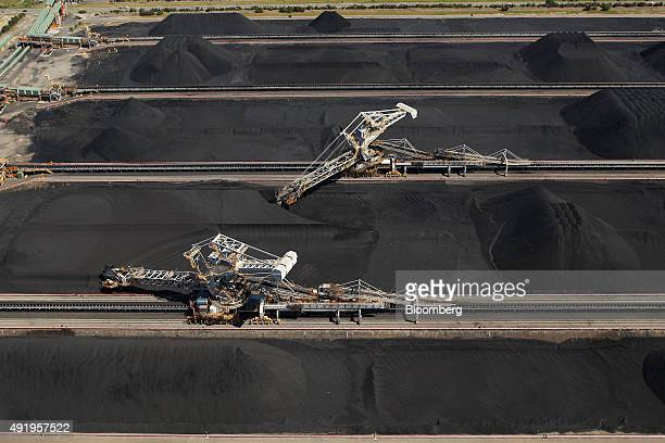 Stackerreclaimers operate next to stockpiles of coal at the Newcastle Coal Terminal in this aerial photograph taken in Newcastle Australia on...