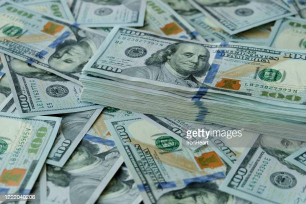 stacking of us dollar bank notes. - currency stock pictures, royalty-free photos & images