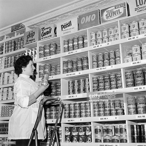 Stacking The Shelves With Canned Food In The Leclerc Store Rue Martel In The 10Th Arrondissement In Paris It Is The Second Leclerc Store After...