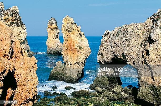 Stacks and natural arch at Ponta da Piedade in Lagos Portugal