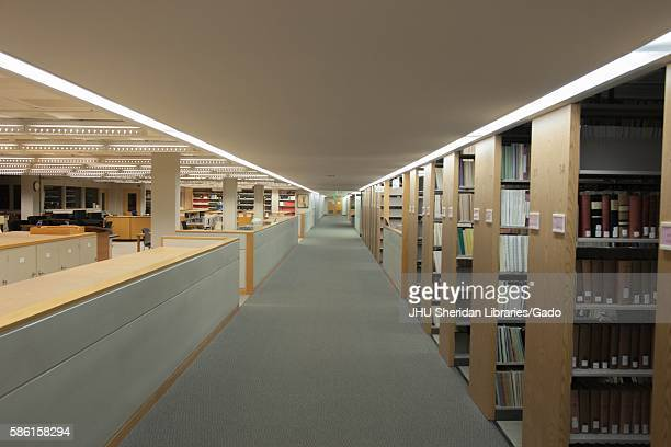 Stacks full of books and study spaces on ALevel of the Milton S Eisenhower Library on the Homewood campus of the Johns Hopkins University in...