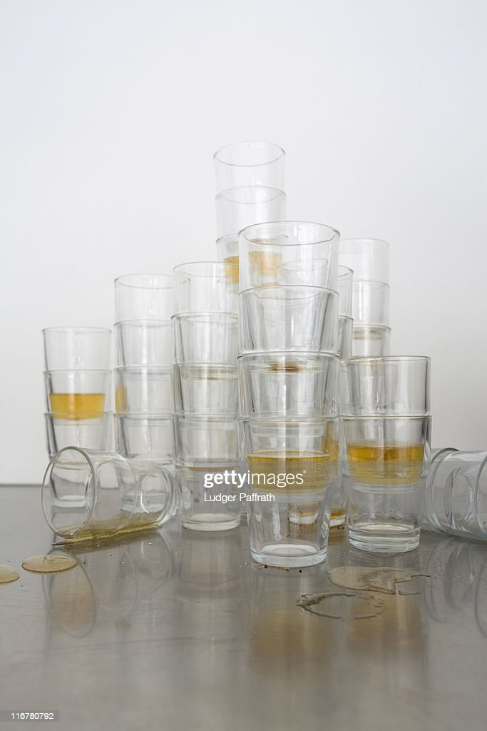 Stacks of beer glasses the morning after a party : Stock Photo