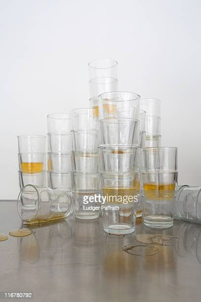 stacks of beer glasses the morning after a party - table after party stock pictures, royalty-free photos & images
