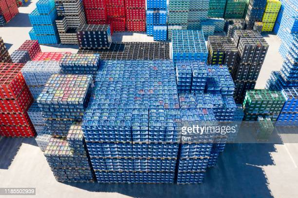stacks of beverage bottle crates, aerial view - bibita foto e immagini stock