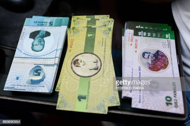 Stacks of bills of the new local community currency the panal launched in the '23 de Enero' workingclass neighbourhood in Caracas are seen at the...