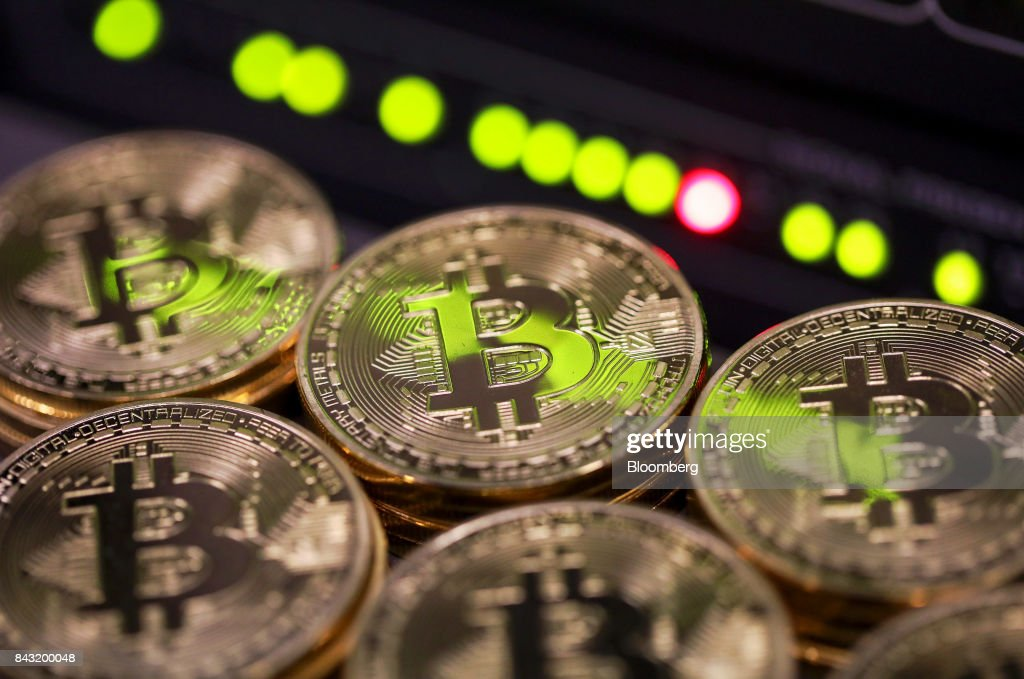 Bitcoins As CryptocurrencyHalts Decline After Drubbing on China's Offerings Ban : News Photo