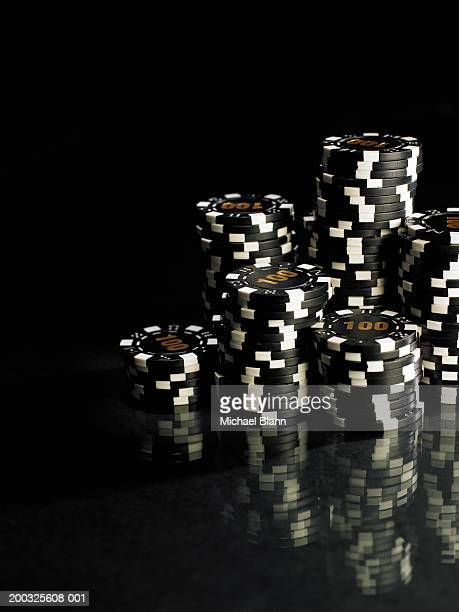 stacks of black and white gambling chips, close-up - gambling stock pictures, royalty-free photos & images