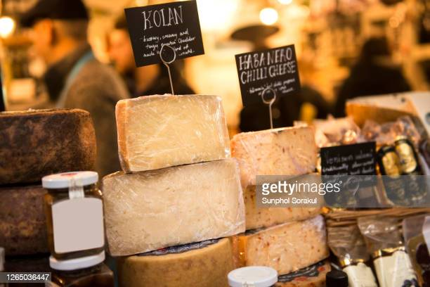 stacks of block cheese on display at borough market - showing stock pictures, royalty-free photos & images