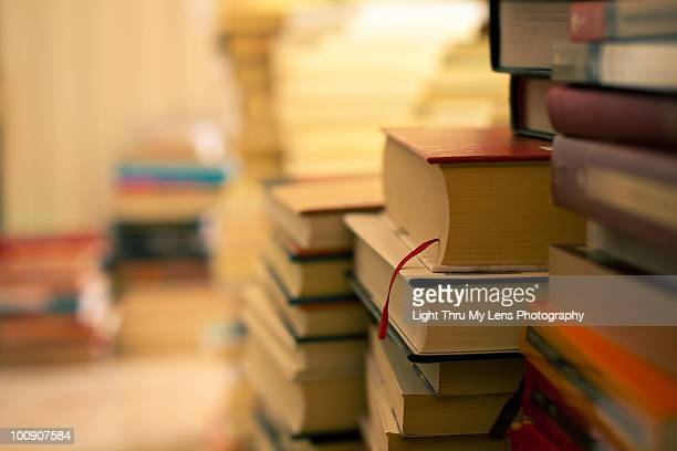 Stacks of Books in Warm Light