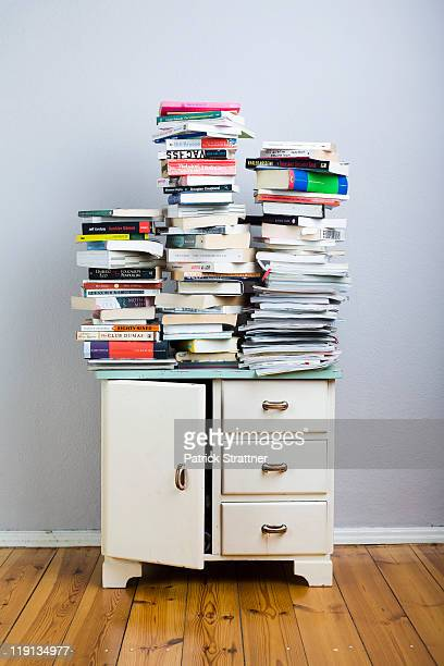 Stacks of books on a cabinet