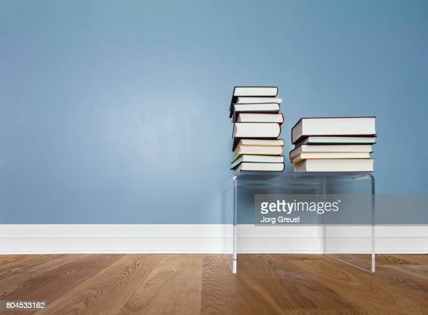 Stacks of books on side table