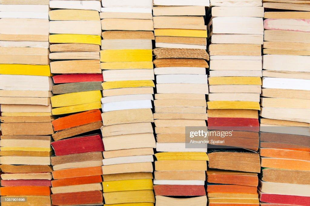 Stacks of books on the shelf : Stock Photo