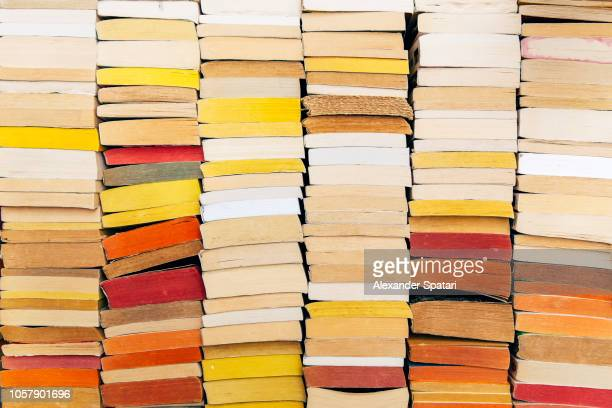 stacks of books on the shelf - collection photos et images de collection