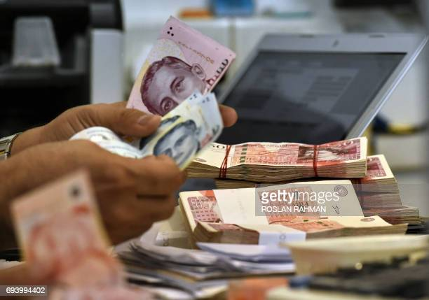 Stacks of British pound are seen at a money changer booth at the financial district in Singapore on June 9 2017 The pound plunged almost two percent...