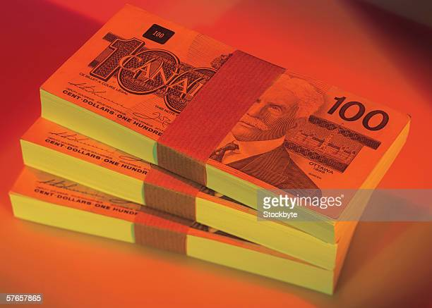 stacks of canadian bank notes (toned) - canadian one hundred dollar bill stock pictures, royalty-free photos & images
