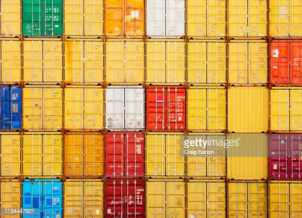 stacks of cargo containers - storage compartment stock pictures, royalty-free photos & images