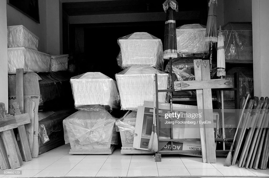 Stacks Of Coffins And Cross In Shop : Stock Photo