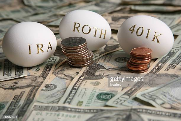 Stacks of coins in bank notes with white eggs